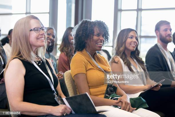 attentive people smile during conference - publicity event stock pictures, royalty-free photos & images
