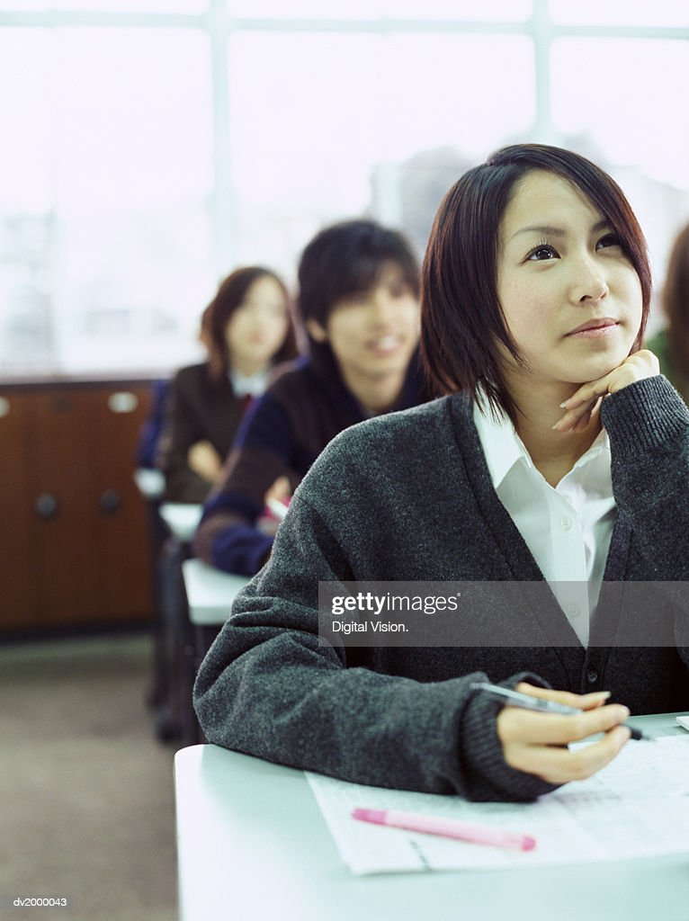 Attentive School Students Sitting in a Classroom : Stock Photo