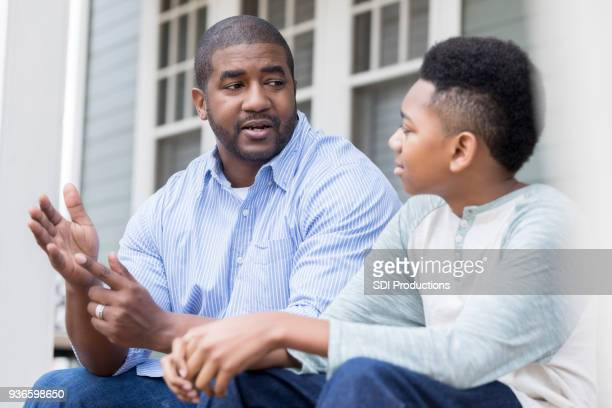 attentive son listening to his dad's advice - pre adolescent child stock pictures, royalty-free photos & images
