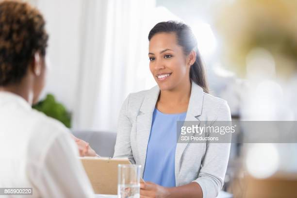 Attentive therapist listens to unrecognizable female patient