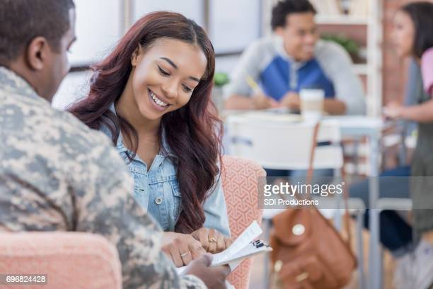 attentive young woman visits with recruiter - recruiter stock pictures, royalty-free photos & images