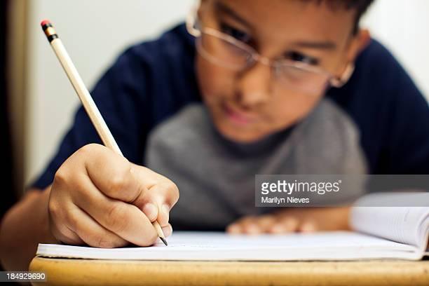 attentively doing homework