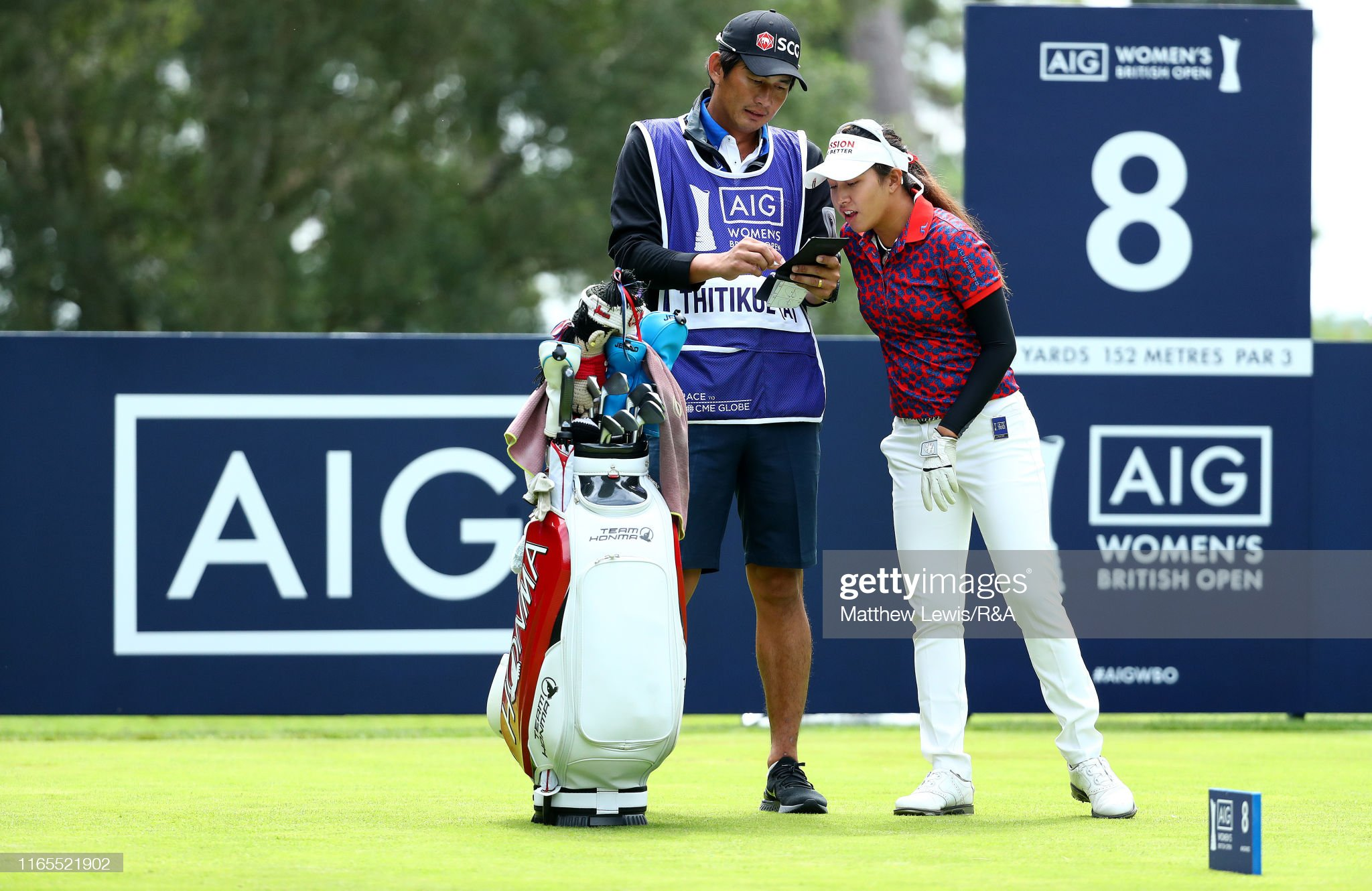 https://media.gettyimages.com/photos/atthaya-thitikul-of-thailand-looks-on-with-her-caddie-during-day-one-picture-id1165521902?s=2048x2048