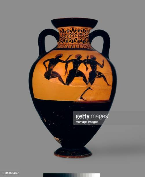 Attic blackfigure Panathenaic amphora with depiction of Athena and Hermes between columns crowned with cockerels and three runners c 540530 BC...