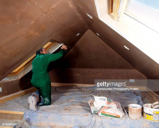 Attic conversion Plaster being applied to the walls