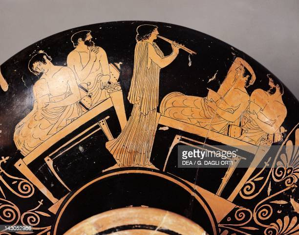 Attic cup depicting a banquet with musicians redfigure pottery from Ruvo Apulia Italy Detail Ancient Greek civilization Magna Graecia 5th Century BC...