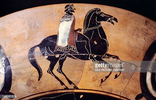 Attic kylix blackfigure pottery Detail showing a figure of a knight on horseback Greece Greek Civilization 6th Century BC Torgiano Museo Del Vino