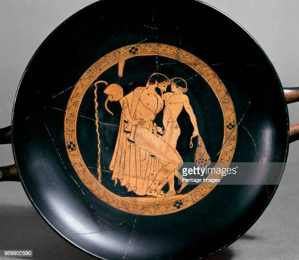 Attic redfigure cup showing a seated man with a naked boy in the inside tondo 470 BC Athenian redfigure cup image of a seated man with a boy...