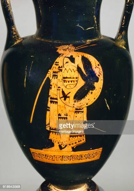 Attic redfigure Nolan amphora showing an armed Thracian warrior with spear and pelta and a youth leaning on a stick 5th century BC Athenian redfigure...