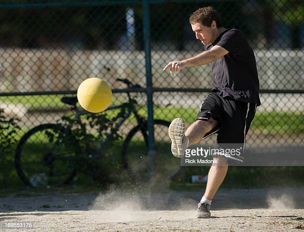 Atticus Croll lays down a mighty kick which turns into a home run Members of a Toronto kickball league play pickup kickball in Alexandra Park in the...