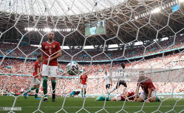 Attila Fiola and Willi Orban of Hungary look dejected after the France first goal scored by Antoine Griezmann during the UEFA Euro 2020 Championship...
