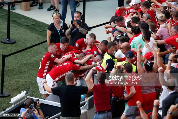 Attila Fiola of Hungary celebrates with the fans after scoring their side's first goal during the UEFA Euro 2020 Championship Group F match between...