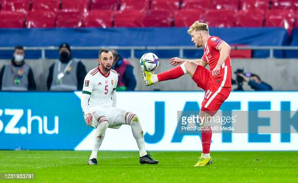 Attila Fiola of Hungary competes with Kamil Jozwiak of Poland during the FIFA World Cup 2022 Qatar qualifying match between Hungary and Poland on...