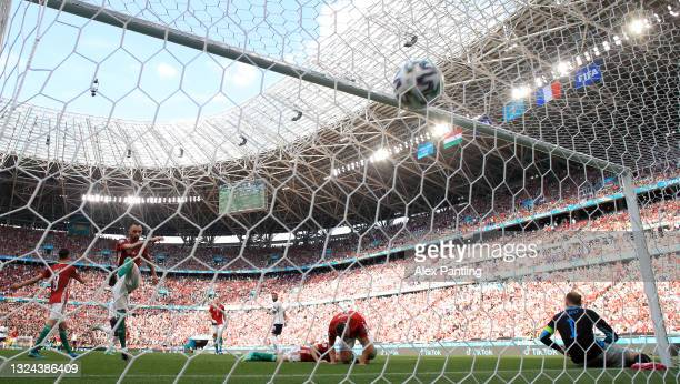 Attila Fiola of Hungary kicks the ball in the net in frustration after the France first goal scored by Antoine Griezmann during the UEFA Euro 2020...