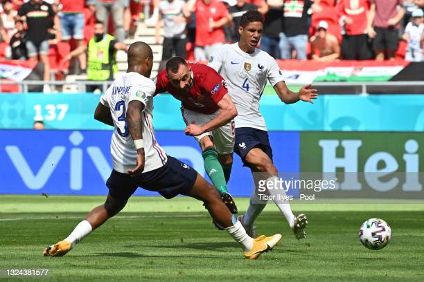 Attila Fiola of Hungary scores their side's first goal whilst under pressure from Presnel Kimpembe and Raphael Varane of France during the UEFA Euro...
