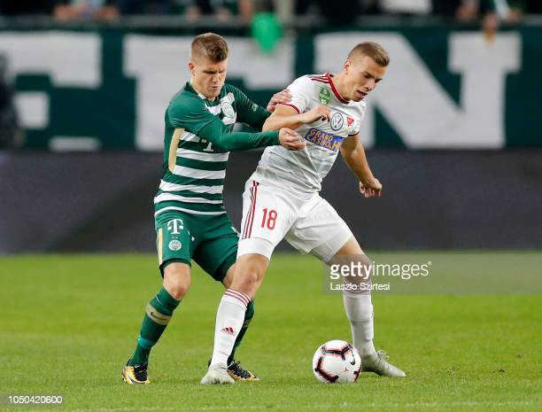 Attila Haris of DVSC covers the ball from David Siger of Ferencvarosi TC during the Hungarian OTP Bank Liga match between Ferencvarosi TC and DVSC at...