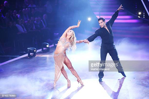 Attila Hildmann and Oxana Lebedew perform on stage during the 2nd show of the television competition 'Let's Dance' on March 18 2016 in Cologne Germany