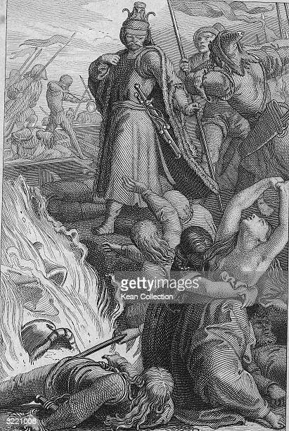 Attila king of the Huns stands and holds a staff as women beg for mercy at his feet while a battle rages around them 453