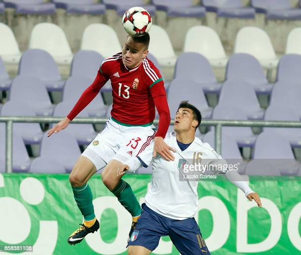 Attila Szalai of Hungary U21 wins the ball in the air from Riccardo Orsolini of Italy U21 during the International Friendly match between Hungary U21...