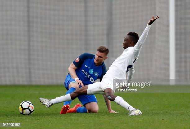 Attila Talaber of MTK Budapest competes for the ball with Obinna Nwobodo of Ujpest FC during the Hungarian Cup Quarter Final 2nd Leg match between...