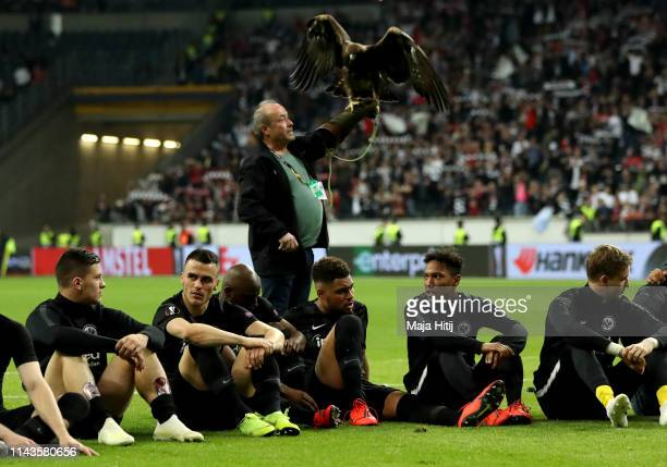 Attila the golden eagle and club mascot is presented to fans as the team celebrate victory during the UEFA Europa League Quarter Final Second Leg...