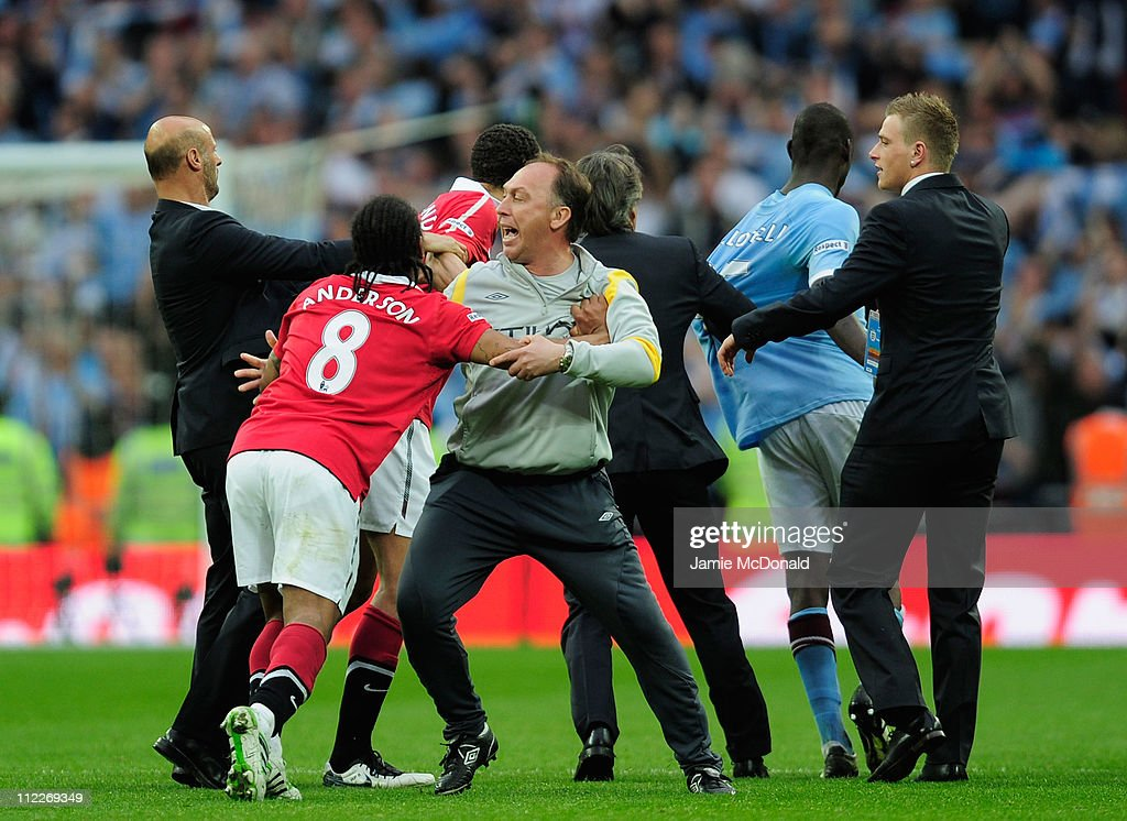 Attilio Lombardo and David Platt of Man City clashes with Anderson of Man Utd at the final whistle during the FA Cup sponsored by E.ON semi final match between Manchester City and Manchester United at Wembley Stadium on April 16, 2011 in London, England.