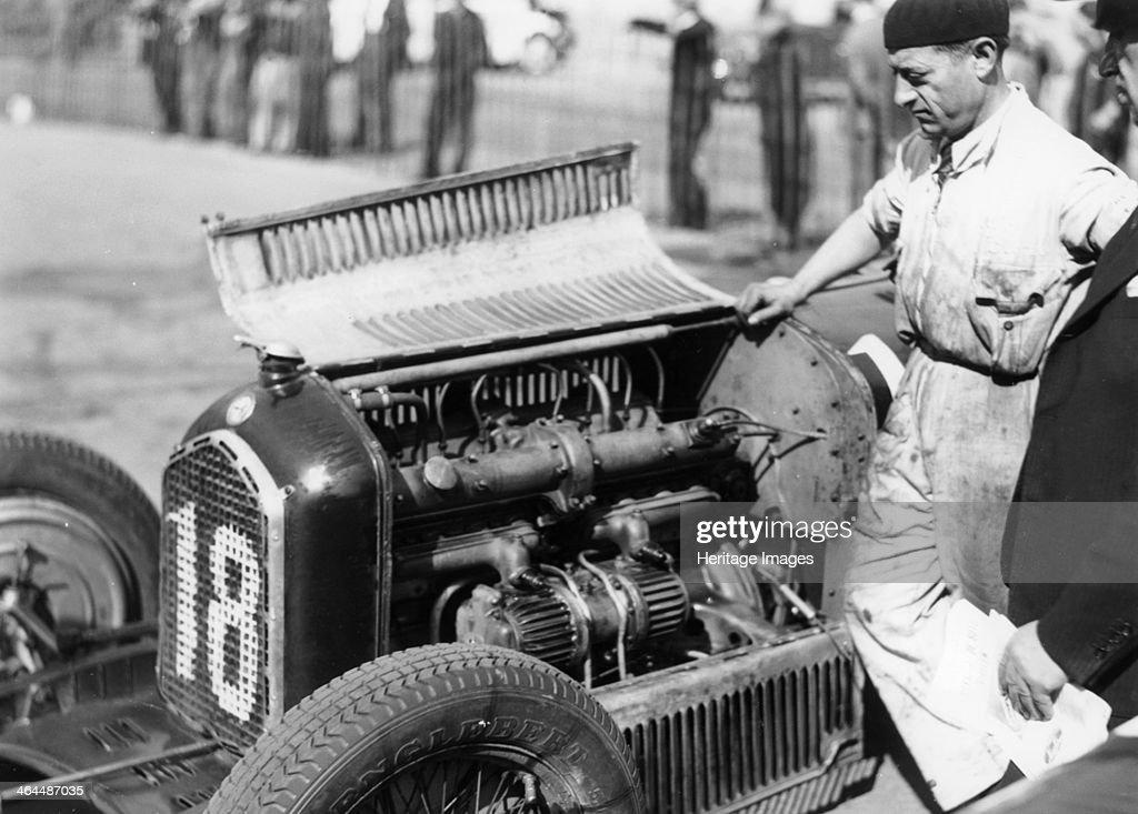 Attilio Marinoni, chief mechanic of Scuderia Ferrari, with an Alfa Romeo, 1934. : News Photo
