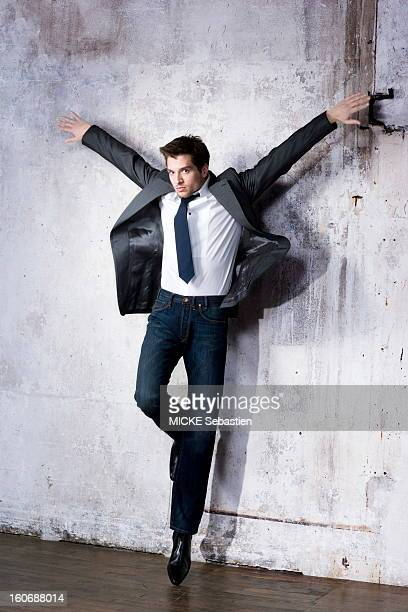 Attitude of a model supported against a wall wearing a gray jacket has two pockets tiny turquoise dots PAUL amp JOE tuxedo shirt in white poplin Yves...