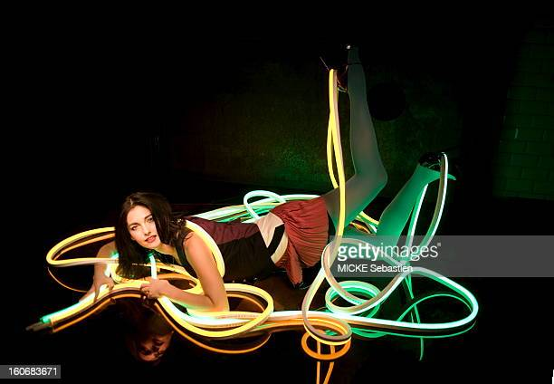 Attitude of oblongata Cristiana REALI by earth humorously twisting in the neon tubes