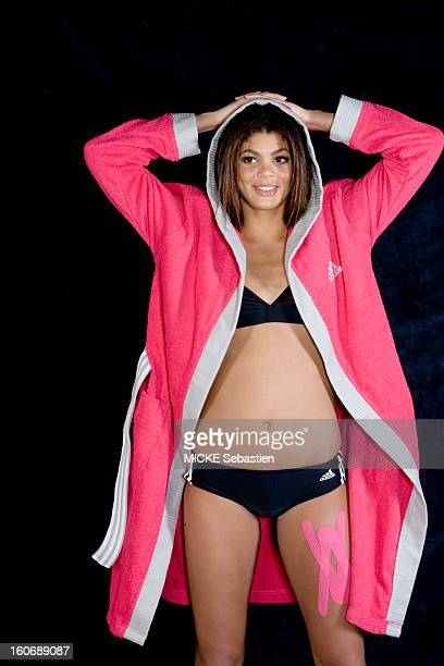 Attitude of the swimmer Coralie Balmy in pink bathrobe opened on a bathing suit twopieces of the trademark 'Adidas' February 2009