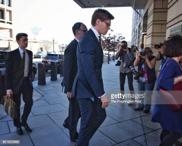 Attorney Alex Van der Zwaan foreground in blue suit arrives at US District courthouse in Washington DC February 20 facing an indictment from Robert...