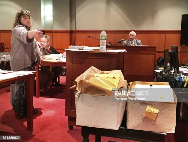 Attorney Amy Fairfield points to two boxes of documents that retired Portland Police detective James Daniels had stored in his home while questioning...
