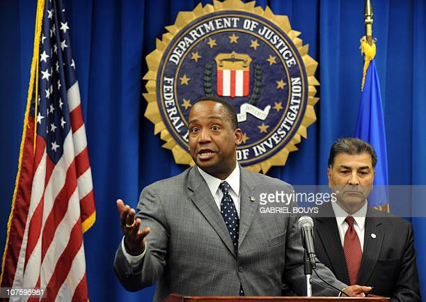 US Attorney Andre Birotte Jr and Steven Martinez Assistant Director of the FBI in Los Angeles speak to reporters on December 14 2010 in Los Angeles...