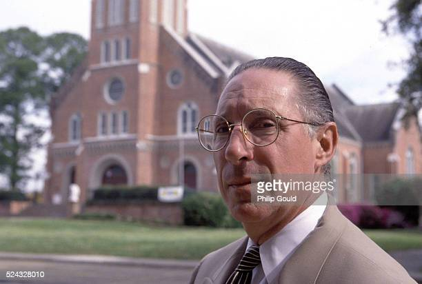 Attorney Anthony Fontana stands in front of St Mary Magdalen Church in Abbeville where dozens of altar boys were molestated by Father Gilbert Gauthe...