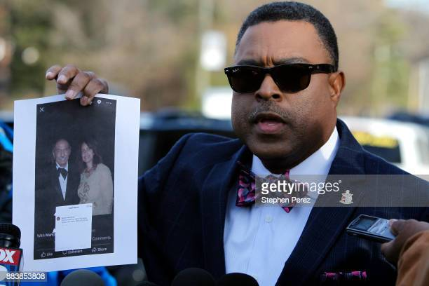 Attorney Arnold Reed displays a photo of Rep John Conyers and Marion Brown outside Conyers home on December 1 2017 in Detroit Michigan Reed is...