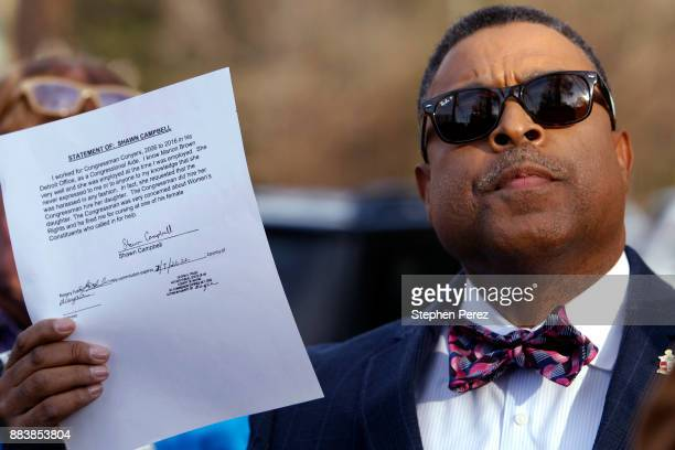 Attorney Arnold Reed displays an affidavit while speaking with the media outside Rep John Conyers home on December 1 2017 in Detroit Michigan Reed is...