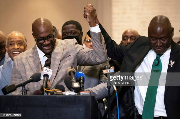 Attorney Ben Crump and Philonise Floyd hold hands during a press conference following the verdict in the trial of former police officer Derek Chauvin...