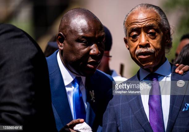Attorney Ben Crump and Rev. Al Sharpton join the family of George Floyd outside the Hennepin County Government Center after the sentencing of Derek...