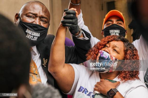Attorney Ben Crump and Tamika Palmer mother of Breonna Taylor celebrate after a news conference on September 15 2020 in Louisville Kentucky It was...