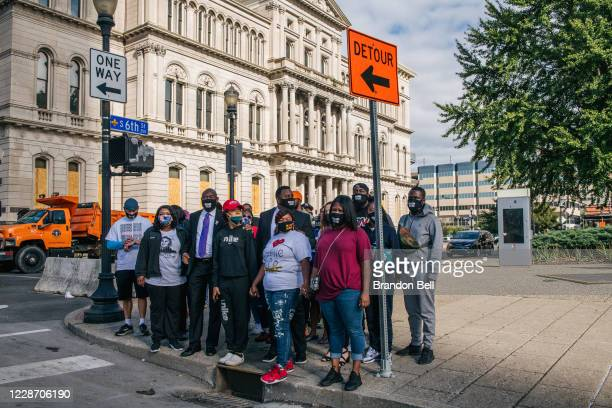 Attorney Ben Crump joins family members of Breonna Taylor ahead of a news conference at Jefferson Square Park on September 25, 2020 in Louisville,...