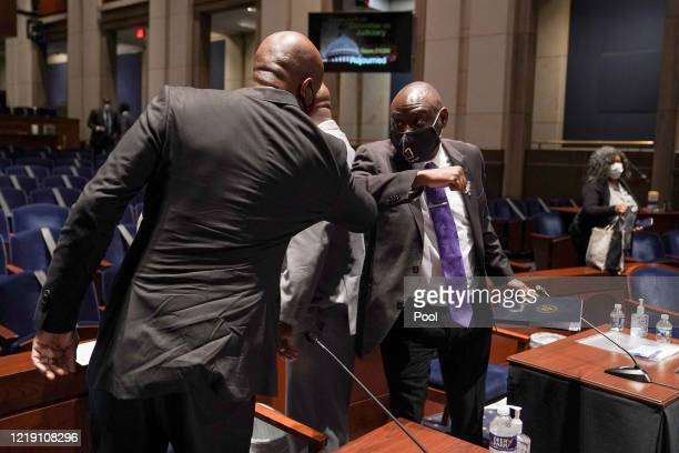 Attorney Ben Crump representing the family of George Floyd bumps elbows with Georgetown University Law Professor Paul Butler after a House Judiciary...