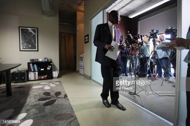 Attorney Benjamin Crump leaves the microphones after speaking with the media about his clients son, 17-year-old Trayvon Martin, who was killed by...