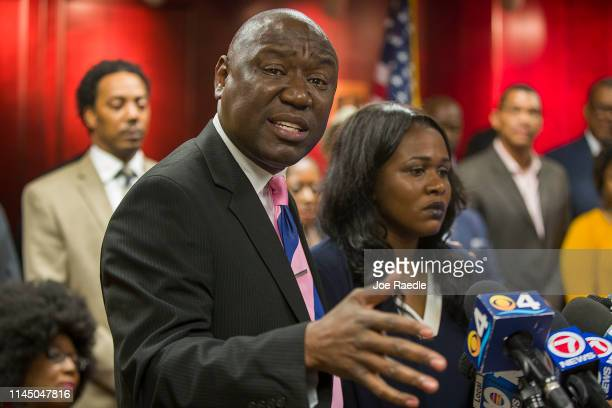 Attorney Benjamin Crump stands with Clintina Rolle mother of Delucca Rolle at the Broward Public Defender's Office as they speak to the media about...