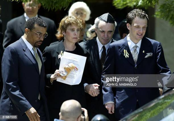 Attorney Billy Martin escorts Dr. Robert Levy , wife Susan and their son Adam after a memorial for their daughter, former Washington intern Chandra...