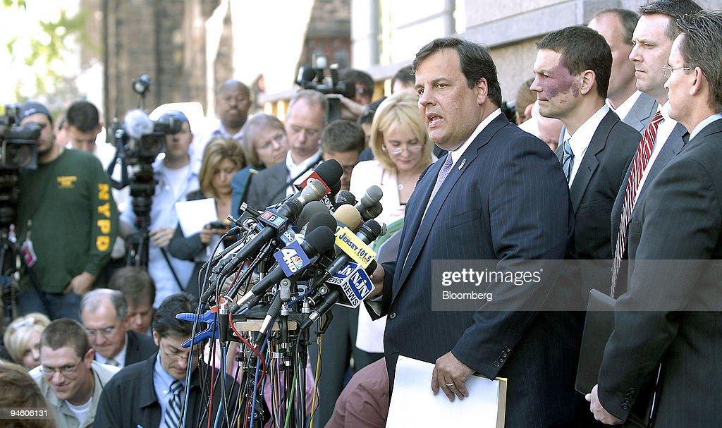 U.S. Attorney Christopher Christie, speaking at podium, hold : News Photo