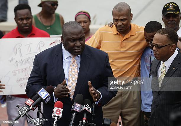 Attorney Daryl D Parks speaks about the shooting death of 18yearold Michael Brown during a news conference as Brown's stepfather Louis Head and...