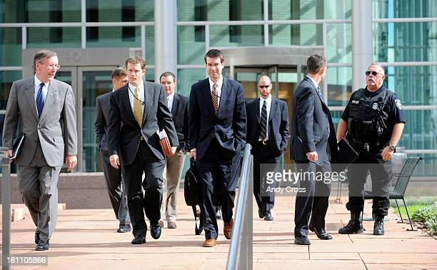Attorney Dave Gaouette left leads others out of the Alfred A Arraj United States Court House in downtown Denver Thursday morning after terror suspect...