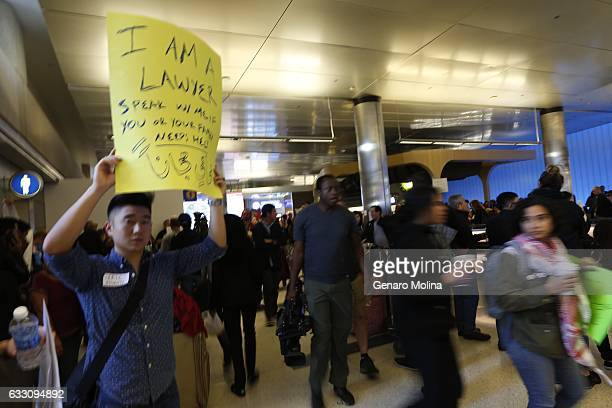LOS ANGELES CA JANUARY 29 2017 Attorney Eric Chen offers his help as people continue to protest President Trump's travel ban at the Tom Bradley...