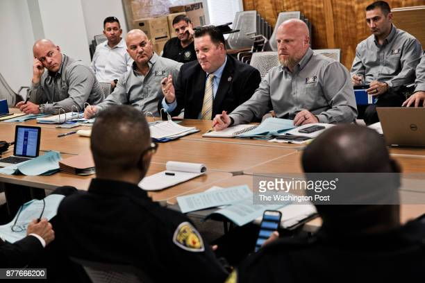 Attorney Eugene Gibbons center speaks during a collective bargaining hearing with his client the Fort Lauderdale Fraternal Order of Police and the...