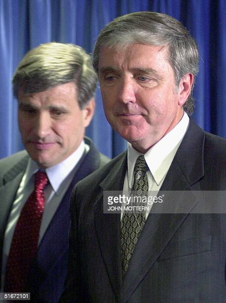 Attorney for the District of Massachusetts Michael Sullivan and FBI Special Agent Charles Prouty speak at a press conference 04 October 2002 after...